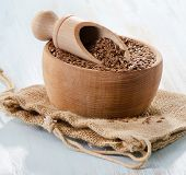 stock photo of flax seed  - Flax seeds on a wooden table - JPG
