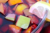 stock photo of sangria  - Tasty sangria in glass bowl close up - JPG