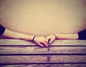 stock photo of bench  - two people holding hands on a bench done with a retro vintage instagram filter - JPG