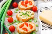 stock photo of scallion  - Delicious bruschetta with cherry tomatoes and scallion - JPG