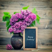 picture of floral bouquet  - bouquet of lilac flowers on wooden background - JPG