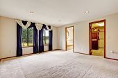 picture of master bedroom  - Bright empty master bedroom with curtains and carpet floor - JPG