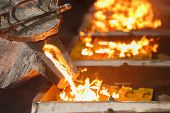 picture of furnace  - pouring molten metal to casting mold of automotive parts - JPG