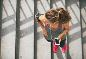 pic of cell  - Portrait of fitness young woman with cell phone outdoors in the city - JPG
