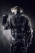 image of anti-terrorism  - Spec ops soldier on black background shot from behind - JPG