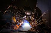 stock photo of welding  - worker welding in production line in industrial - JPG