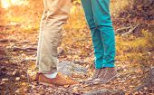 picture of woman boots  - Couple Man and Woman Feet in Love Romantic Outdoor with Autumn season nature on background Fashion trendy style - JPG