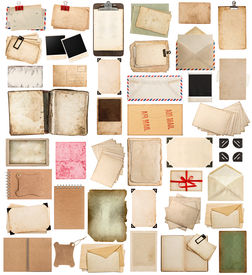 stock photo of vintage antique book  - aged paper sheets books pages and old postcards isolated on white background - JPG