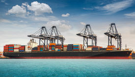 picture of tariff  - Container ship berthing port with crane un loading - JPG