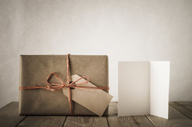 pic of text-box  - A gift box wrapped in brown paper and tied with raffia with blank label facing front - JPG
