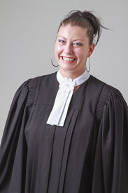 picture of toga  - woman in her thirties wearing a black toga with great big smile - JPG