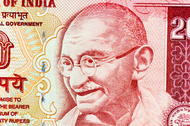 stock photo of gandhi  - Closeup macro view of Mahatma Gandhi on an Indian currency note - JPG