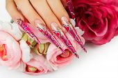 stock photo of nail-design  - Female hand with manicure  and beautiful  design on  nails - JPG
