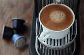 stock photo of brew  - Cup of freshly brewed espresso from a capsule - JPG