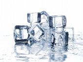 foto of ice cube  - Melting ice cubes on white bacground - JPG
