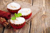 stock photo of bakeshop  - Homemade Muffins Ready for Breakfast on a wooden background - JPG