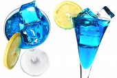 picture of alcoholic drinks  - Blue cocktail with lemon garnish and ice cubes - JPG
