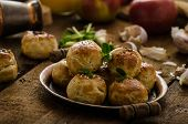 stock photo of sesame seed  - Cheese mini buns from home dough sprinkled with sesame seeds poppy and caraway seeds orange juice fresh apple and herbs on top - JPG