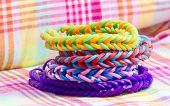 image of loom  - close up of colorful elastic loom bands color full - JPG