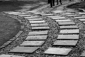 picture of curves  - Curved and tilted path to success for business man - JPG