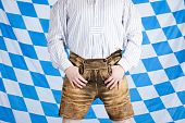 image of upper thigh  - Bavarian man with brown Oktoberfest leather pants  - JPG