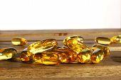 stock photo of prophylactic  - dietary supplement pills on wooden desk - JPG
