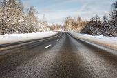 stock photo of slippery-roads  - Danger and fast turn at the icy snow road