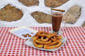 stock photo of churros  - Hot chocolate drink and churros with receipt and change Andalucia Spain Western Europe - JPG