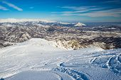 picture of italian alps  - Free ride ski tracks on snowy slope - JPG