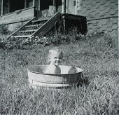 stock photo of washtub  - vintage photo of a blonde baby  - JPG