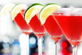 foto of vodka  - A cosmopolitan or informally cosmo is a cocktail made with vodka triple sec cranberry juice and freshly squeezed lime juice or sweetened lime juice - JPG