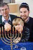Jewish Family Lighting Chanukah Menorah
