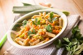 stock photo of leek  - pasta with carrot leek and pine nuts - JPG