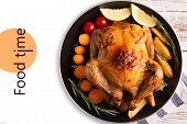 stock photo of roast chicken  - Roasted chicken and vegetables on the wooden table  - JPG