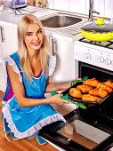 picture of baps  - Young woman bake cookies at home kitchen - JPG