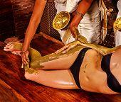 stock photo of panchakarma  - Young woman having feet Ayurveda spa massage - JPG