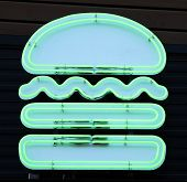 picture of neon green  - A green neon sign in the shape of a hamburger - JPG