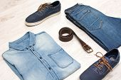 foto of no clothes  - many jean clothes and shoes on wood background - JPG