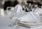 stock photo of banquet  - Elegant and beautiful white banquet wedding table setting - JPG