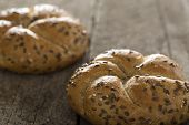 stock photo of flax seed  - Close up of a flax seed bagel over wooden background - JPG