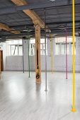stock photo of pole dance  - Picture of color pylons in pole dance class - JPG