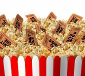 stock photo of popcorn  - Movie popcorn tickets border as a group of popped corn snacks with cinema ticket stubs in the food as a theatrical symbol for entertainment and the arts on an isolated white background - JPG