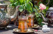 foto of arabian  - Arabian mint tea served in the summer garden - JPG