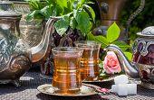 image of arabian  - Arabian mint tea served in the summer garden - JPG