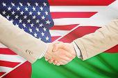 foto of oman  - Businessmen shaking hands  - JPG