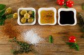 foto of vinegar  - Dressing ingredients on rustic wooden background - JPG