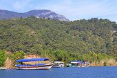 stock photo of dalyan  - Pleasure boats on Dalyan river in Turkey - JPG