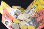 stock photo of fifties  - Australian fifty and twenty dollar notes and an assortment of coins - JPG