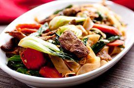 stock photo of stir fry  - decadent thai beef stir fry pad see ew style - JPG