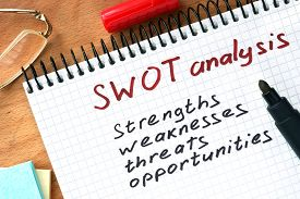 picture of swot analysis  - Notepad with  SWOT analysis concept on a wooden board - JPG